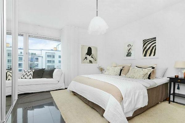 Phòng ngủ thiết kế đơn giản và lấy màu trắng là màu chủ đạo