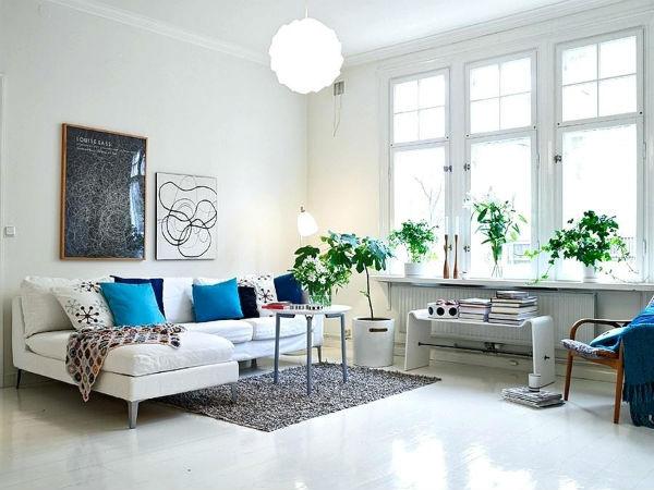 Phòng khách bừng sáng với thiết kế màu trắng tinh khôi